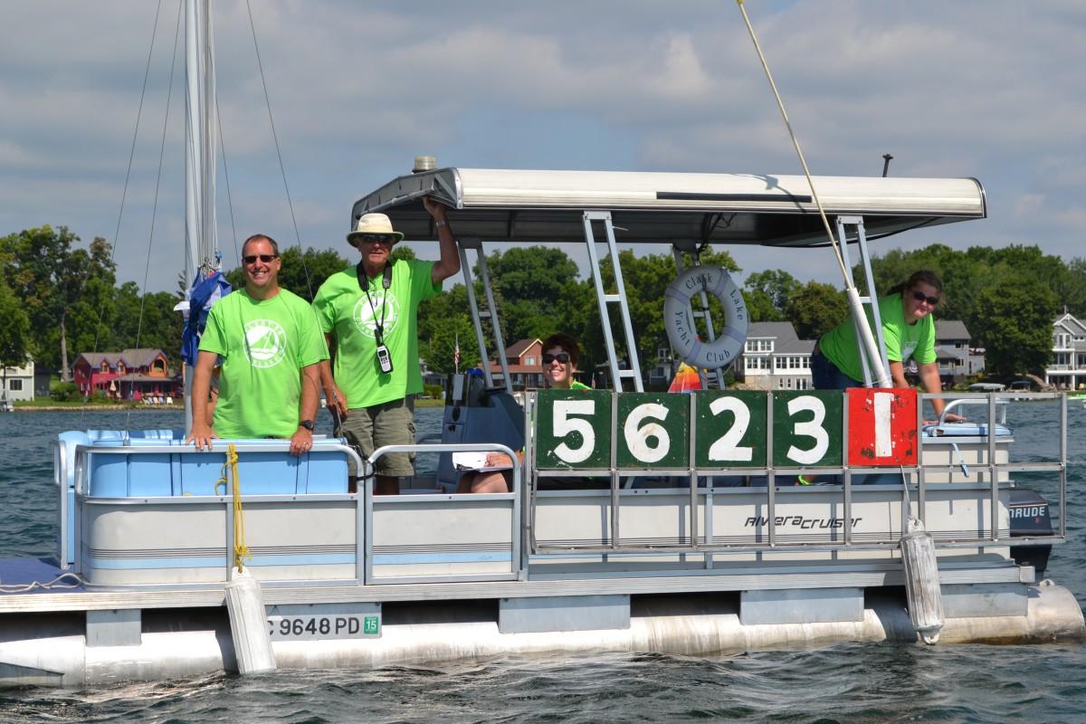Yacht Club staff officiating the race--foreground Bill Locke & Neil Robb