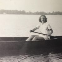 Angela Rensch Ligibel in an early photo at Clark Lake in a favorite canoe.