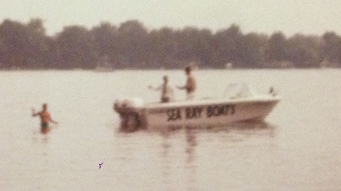 This is the Sea Ray towboat with the high gunwales.  In this photo, Buzz is preparing to ski in the tournament.