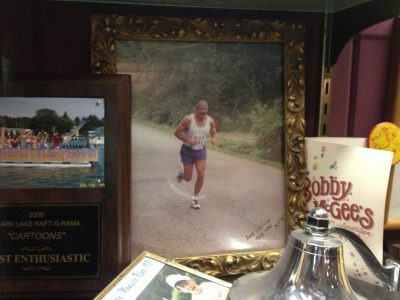 View of a memorabilia display at the Beach Bar.  Included is a photo of Tom Collins running competitively.