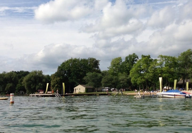 This view of the Clarklake Beach and Boat Club does not include most of the many rented boat slips, but it does give a view of the permanent pier.  For many years this facility operated for the benefit of the employees of Consumers Power