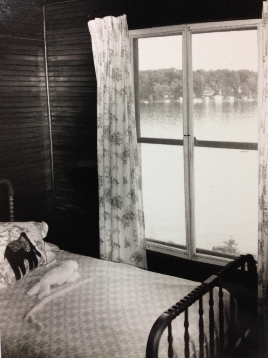 An upstairs bedroom. The view from the window is towards cottages that line Eagle Point on the west part of the lake.