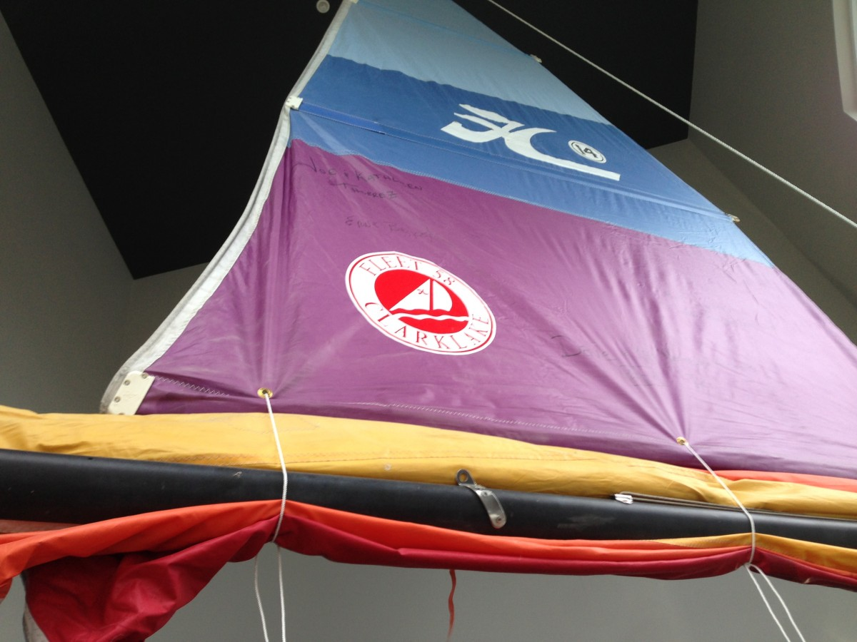 This sail from a Fleet 58 Hobie hangs in the foyer of the Pointe Bar and Grill at Eagle Point
