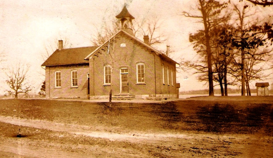 Clark Lake School House, about 1900, located in what is now the Columbia Towhship Park on Hyde Road.  Notice the small building to the far right.