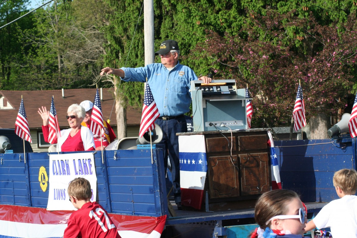 Lions Club President Walt Reed greets spectators from the Lions Club float