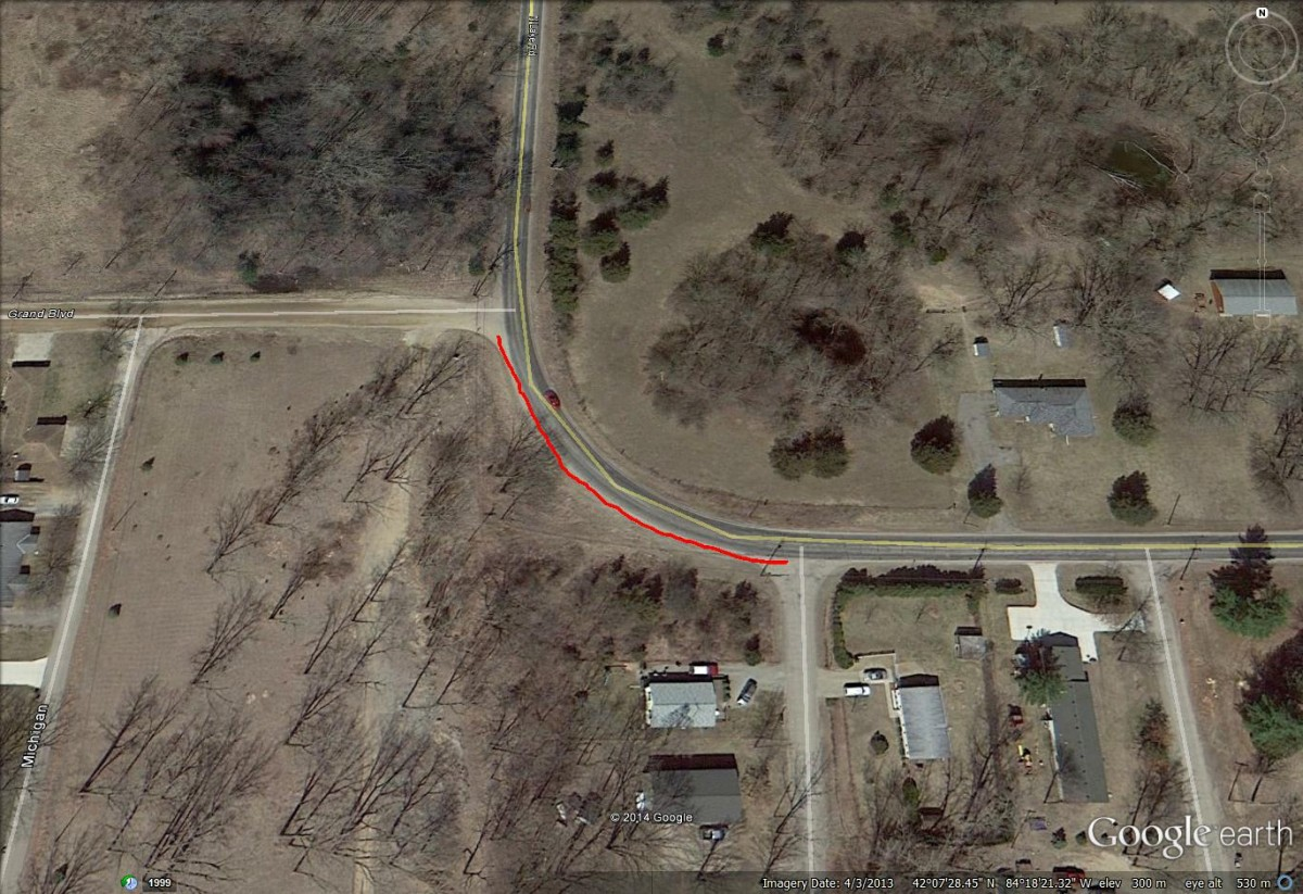 Google Earth photo of North Lake Road from Rita Dr. to Grand Blvd. The extension of the Spirit Trail will follow the red path line overlaying this satellite photo.