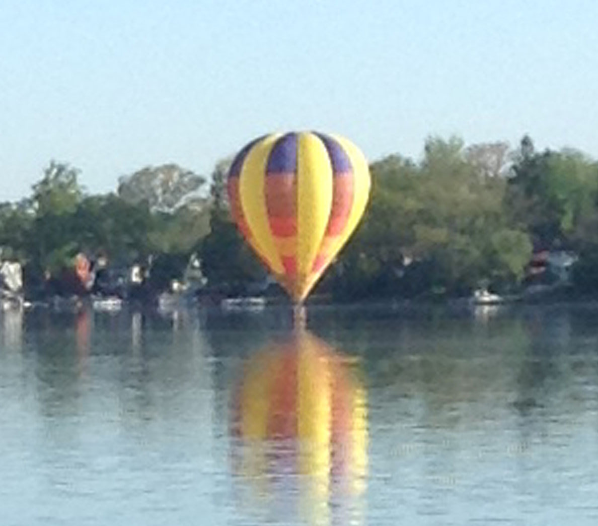 Mike and Nancy Ligibel, on the southeast shore of the west side of the lake, took this photo as the balloon touched the water across from them.
