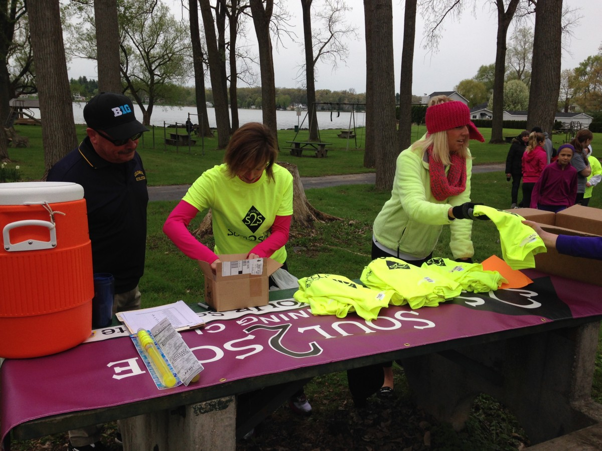 Roy Lamberson, Jen Hittle and Jessica White at the registration site