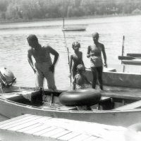 Max (dad) and sisters Sally  &  Jackie June, Ron in boat