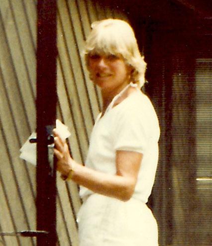 Ann Clark walking-into-house
